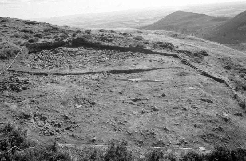 Excavation photograph : area VII - at level of f705, looking south.