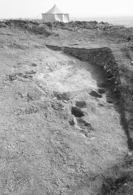 Excavation photograph : area I - final photo of south rampart, from west, without ranging rods.
