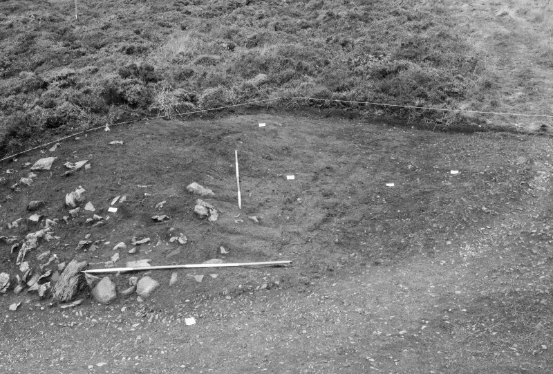 Excavation photograph : area I - north rampart and track, looking north, f102, 106, 109, 111.