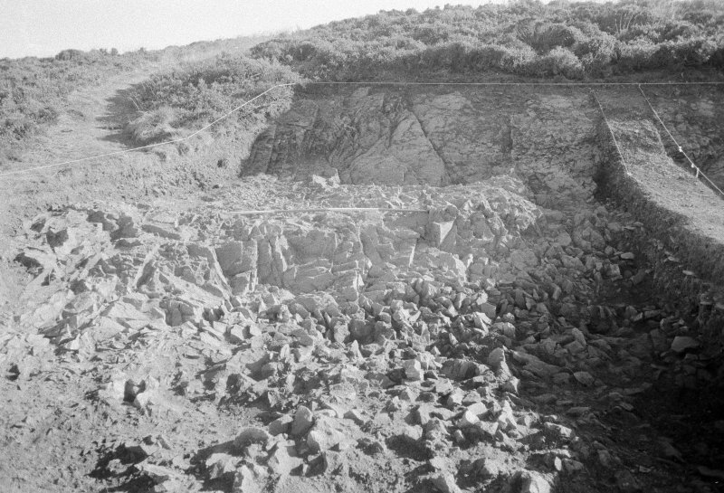 Excavation photograph : area II - face of cut ledge and back wall in northern half, looking east.