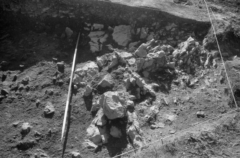 Excavation photograph : area II - northern half, western limit of rock, looking south.