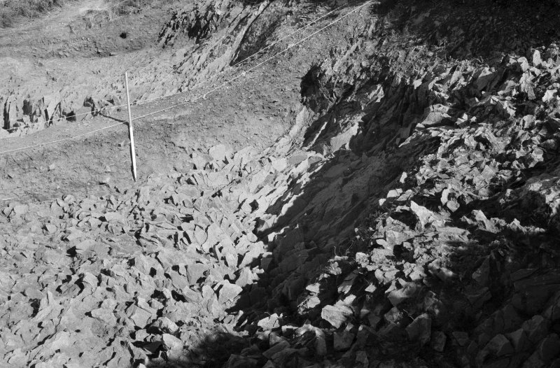 Excavation photograph : area II - southern half, rock face, looking east.