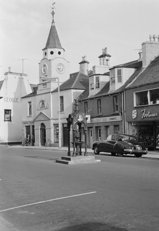View of Old Town Hall, Stranraer, from north west, and the Railway Inn and a fountain