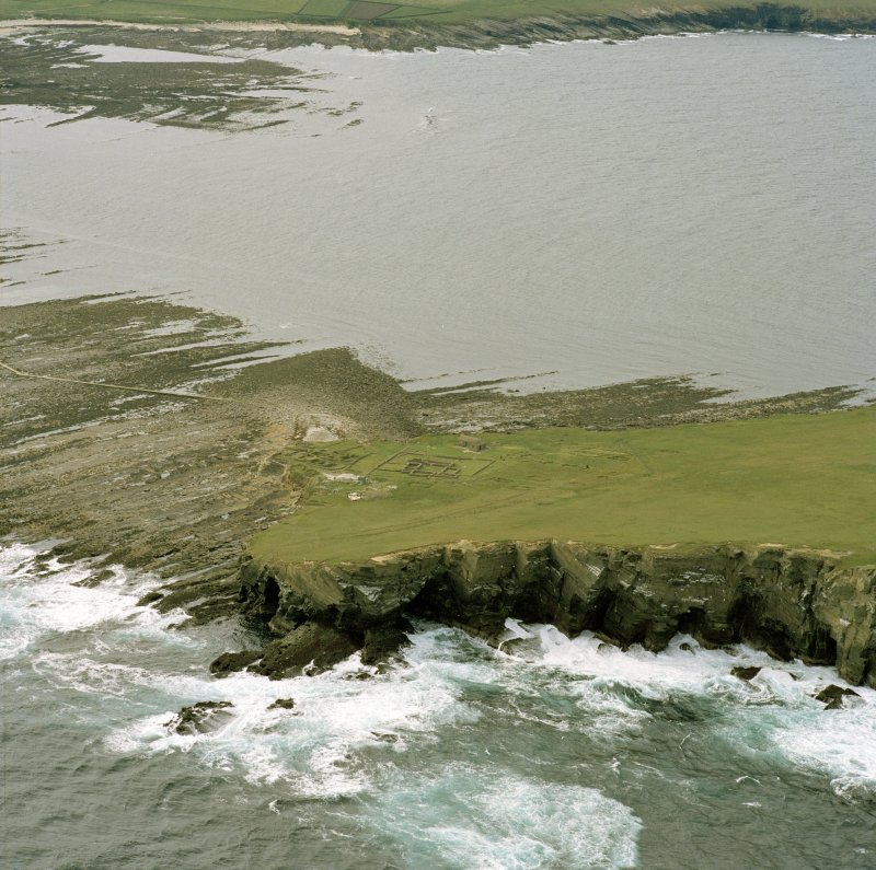 Oblique aerial view of the chapel and settlement at Brough of Birsay