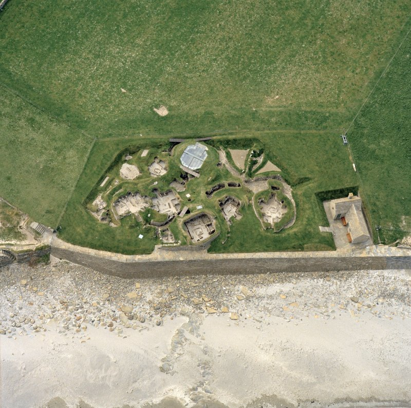 Oblique aerial view centred on the prehistoric settlement at Skara Brae, Orkney
