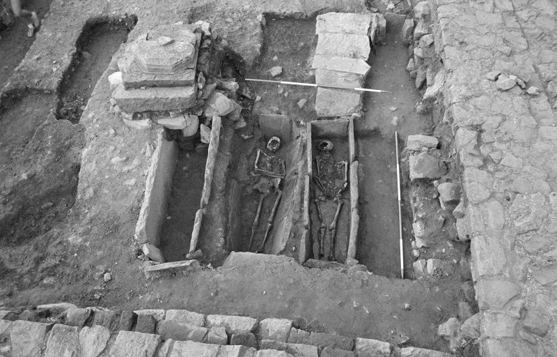 Jedburgh Abbey excavation archive Frame 15: Area 1: Room 3, showing Grave 826 with Skeleton 9 and Grave 822 with Skeleton 5. From E.
