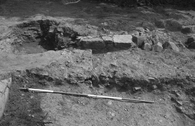 Jedburgh Abbey excavation archive Frame 30: Area 1: Trench J, showing Wall 922, layer 927 and pit 292. From W.