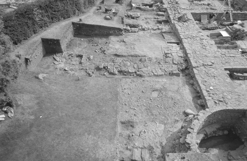 Jedburgh Abbey excavation archive Frame 3: Area 1: N end of Trench J, showing Walls 194 and 198 in foreground with mortar floor 256 behind. From N.
