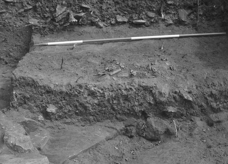 Jedburgh Abbey excavation archive Frame 16: Area 1: Trench J: Disturbed grave 957. From W.