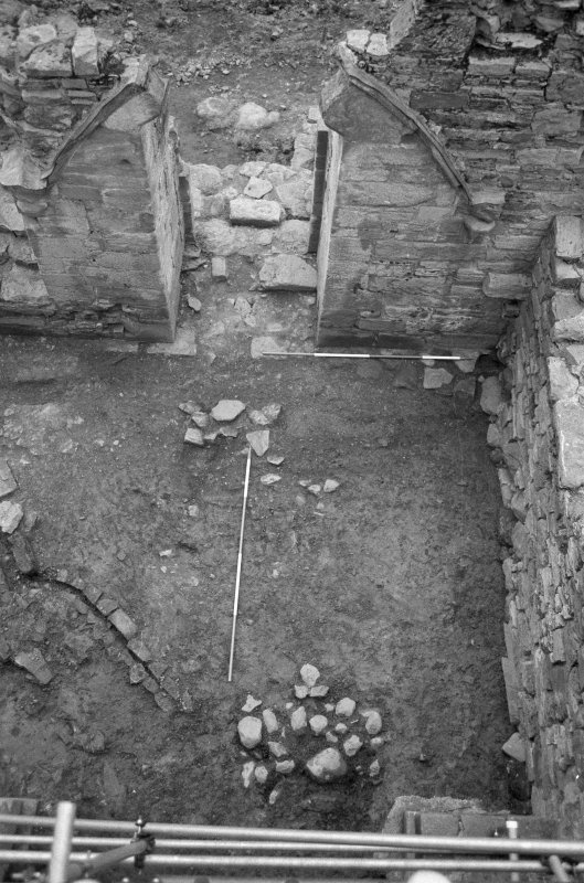 Jedburgh Abbey excavation archive Frame 24: Area 1: Room 11: Compact surface 977 and W door of building.
