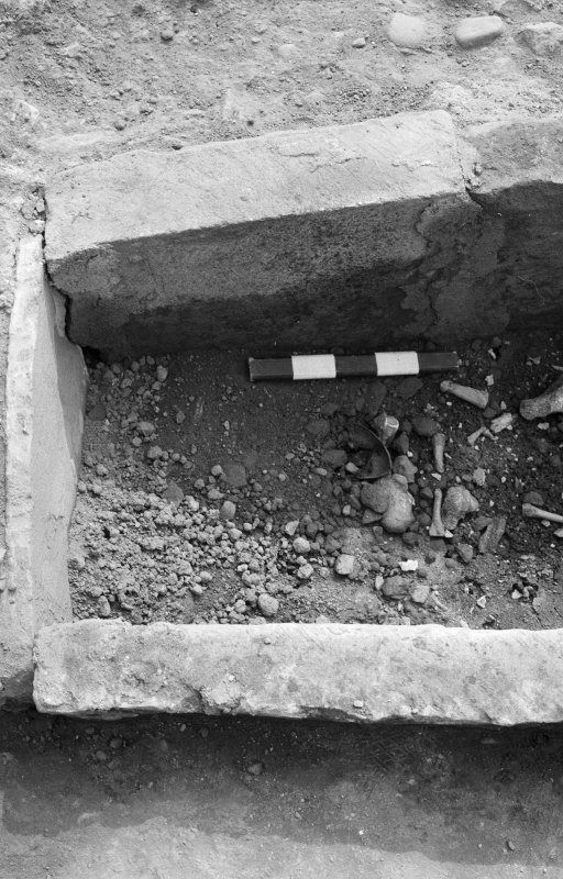 Jedburgh Abbey excavation archive Frame 28: Area 1: Room 3: Detail of Grave 872. From N.