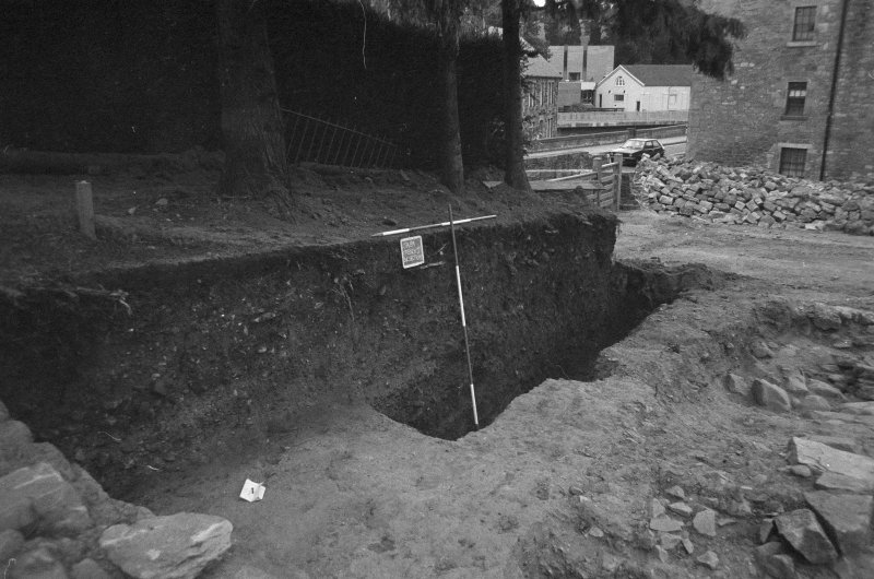 Jedburgh Abbey excavation archive Frame 19: Area 1: S end of Trench J prior to removal of road. From NW.