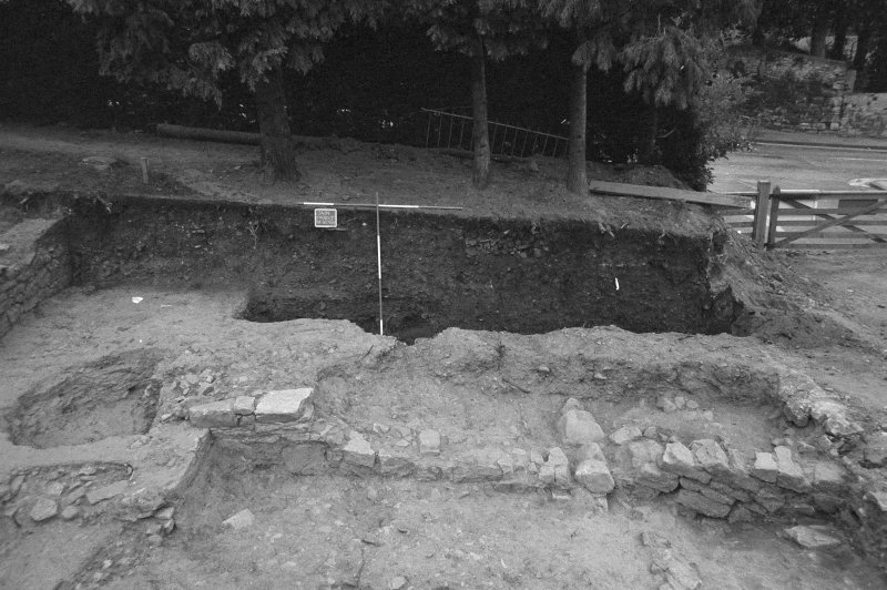 Jedburgh Abbey excavation archive Frame 21:  Area 1: S end of Trench J prior to removal of road. From W.