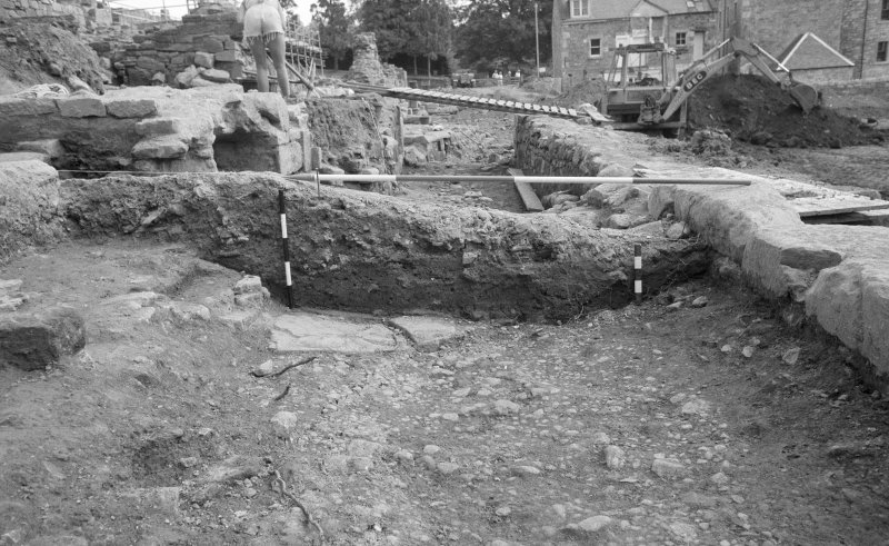 Jedburgh Abbey excavation archive Frame 23: Area 2: Trench F: Section between 502 and 378, showing 557 and 551. From W.