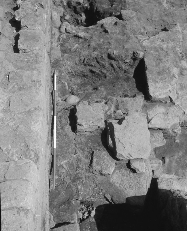 Jedburgh Abbey excavation archive Frame 24: Area 2: Trench G: W end of 400, showing capstones of drain 386. From W.