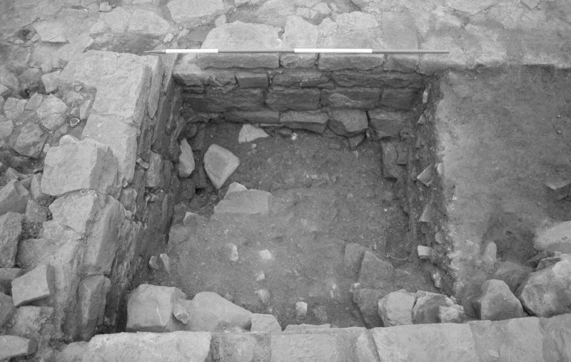 Jedburgh Abbey excavation archive Frame 5: Area 2: Trench G: East sondage through 400 complete; wall 375 at bottom, 385 to left and top.