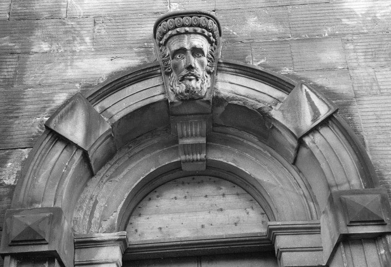 Detail of entrance arch of Tolbooth with carved head keystone, Broad Street, Stirling