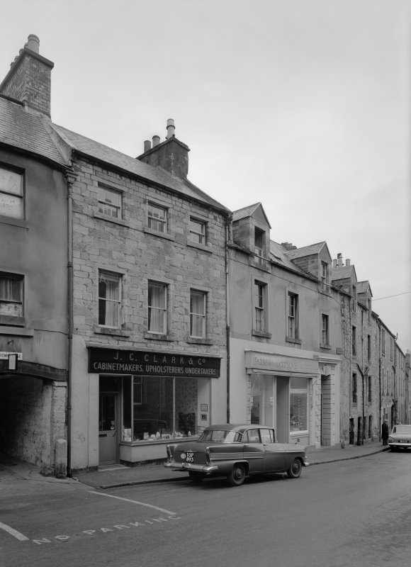 View of south elevations of 14-18 Canongate, Jedburgh from west, showing the premises of Robert Douglas and J C Clark & Co cabinetmakers, upholsterers and undertakers.