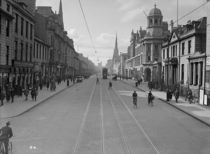 View of Union Street, Aberdeen showing bicycles and tram