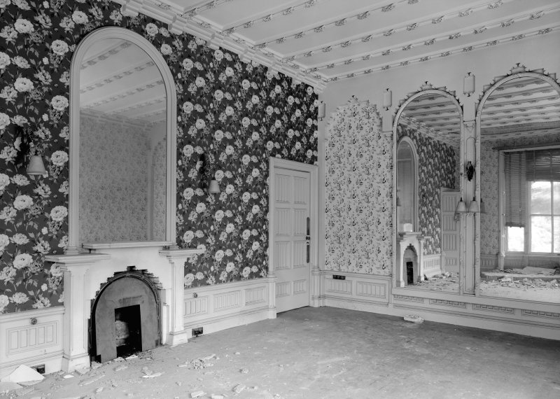 Interior view of Rockville, 3 Napier Road, Edinburgh, showing a room with large arch-topped mirrors, a ribbed ceiling with gilded flowers, a fireplace with a stepped interior arch and wallpapers with  ...