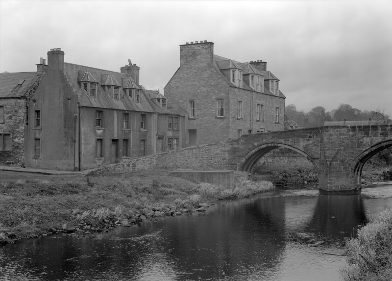 View of Duck Row and Canongate Bridge, Jedburgh from south east from east riverbank.