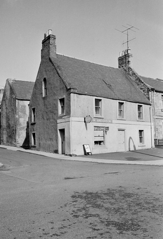 View of 28 Newtown Street, Duns showing the premises of J & M Anderson and the corner to Gourlays Wynd from south west.