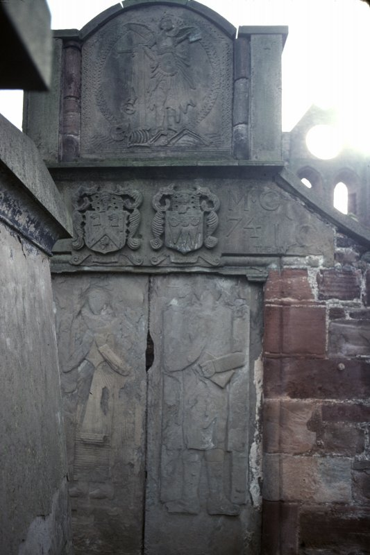 View of mural monuments with carved effigies and armorial panels, Arbroath Abbey Churchyard.