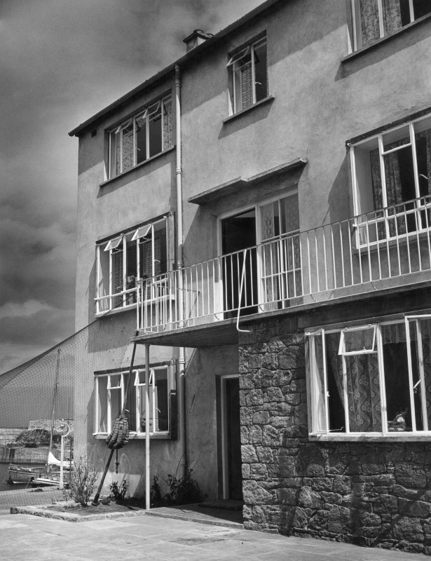 Dunbar, Victoria Street, Harbour Housing. Photographic view of three-storey courtyard block looking towards harbour. Insc. on verso: 'Fishermens' houses at Dunbar. Messrs Basil Spence and Partners, Architects.'
