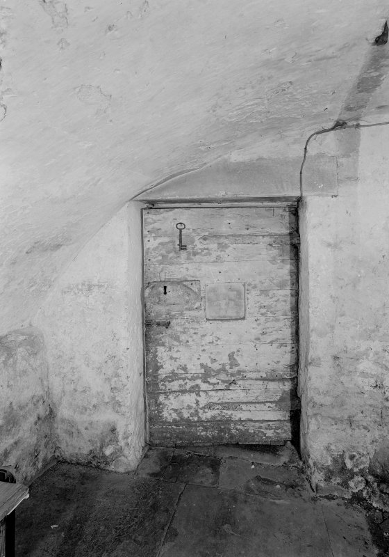 Detail of door in cellar on ground floor of main block, Auchenbowie House.