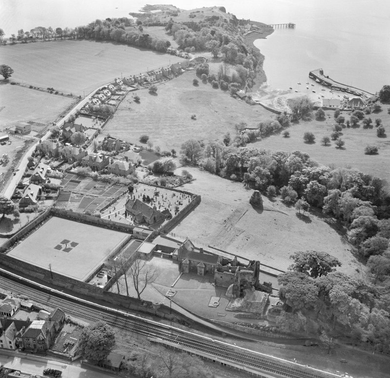 Oblique aerial view of Aberdour village, showing Aberdour Castle, St Fillan's Church and the harbour