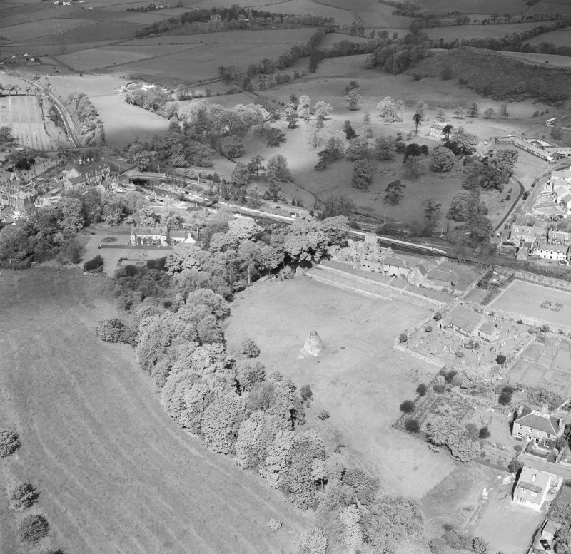 Oblique aerial view of Aberdour village, showing Aberdour Castle and St Fillan's Church