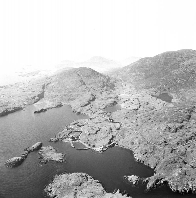 Oblique aerial view of Rodel, Harris, showing a distant view of St Clement's Church.