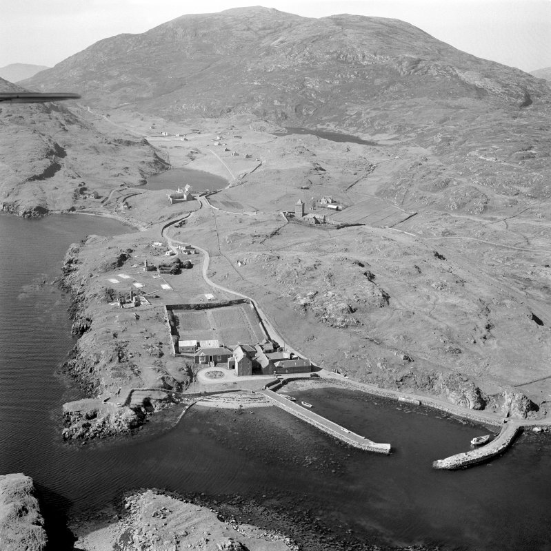 Oblique aerial view of Rodel, Harris, showing the harbour and St Clement's Church