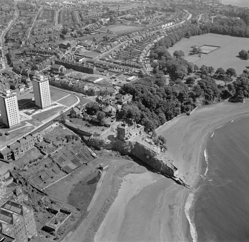 Oblique aerial view centred on Ravenscraig Castle, Kirkcaldy, showing Pathhead tower blocks from south west.