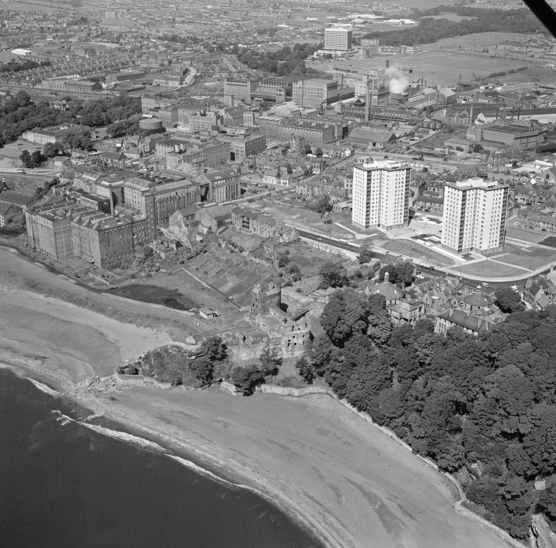 Oblique aerial view centred on Ravenscraig Castle, Kirkcaldy, showing Pathhead tower blocks and Ravenscraig Maltings from east.