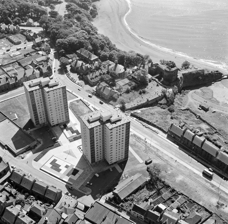Oblique aerial view of Ravenscraig Castle and Pathhead tower blocks, Kirkcaldy from north west.