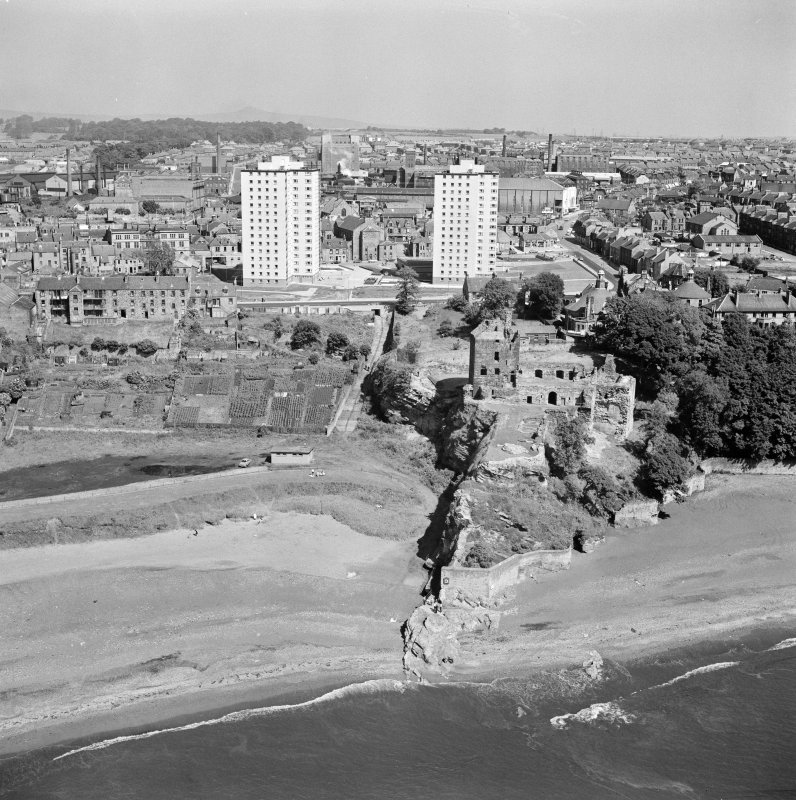 Oblique aerial view of Ravenscraig Castle and Pathhead tower blocks, Kirkcaldy from south.