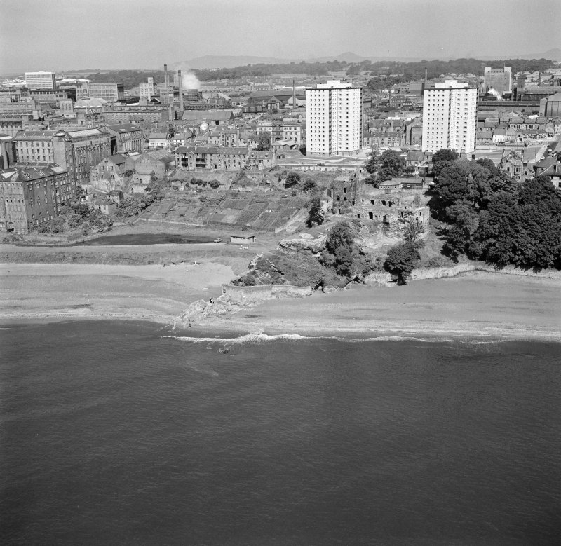 Oblique aerial view of Ravenscraig Castle and Pathhead tower blocks, Kirkcaldy from south east.