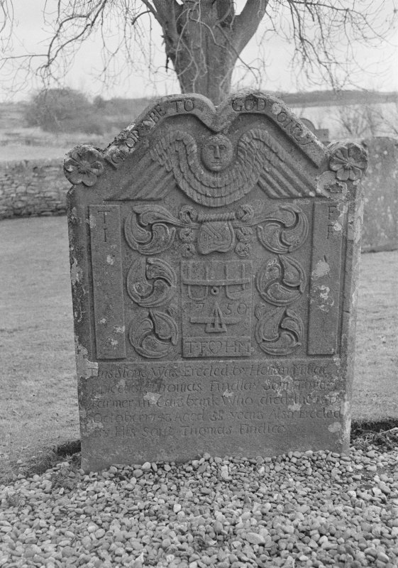 View of west face of gravestone of Thomas Findlay 1743 and his son Thomas 1750 in the churchyard of Rescobie Parish Church.