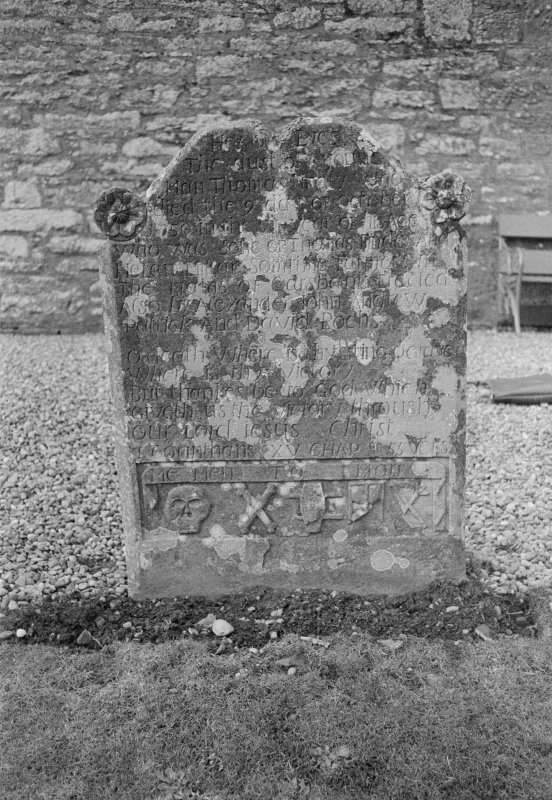 View of east face of gravestone of Thomas Findlay 1743 and his son Thomas 1750 in the churchyard of Rescobie Parish Church.