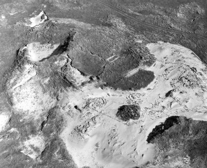 Oblique aerial view of Coileagan An Udal settlement, North Uist