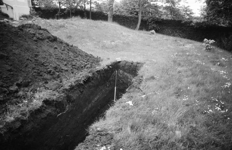 Excavation photograph : details of west facing section, trench D, looking east.