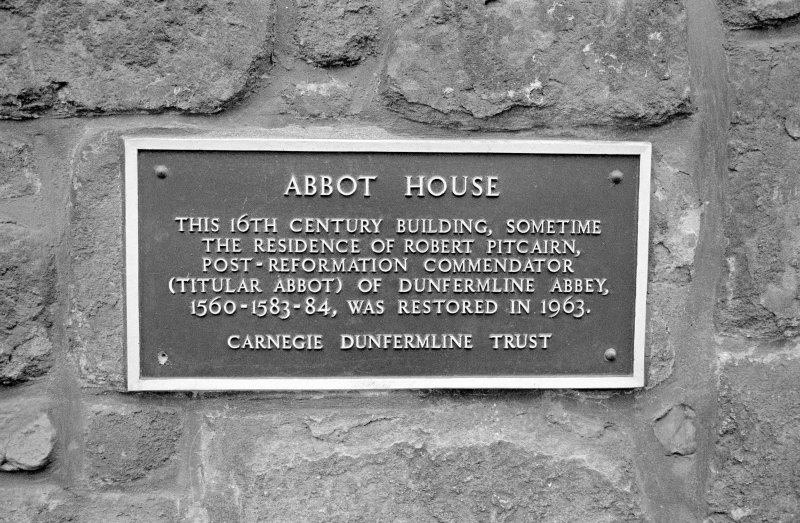 Plaque on front of house.
