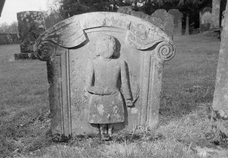 View of rear face of gravestone commemorating John Scott, a tenant farmer, who died in 1752 and his wife, Jean Goodfellow, who died in 1783, Teviothead Churchyard.
