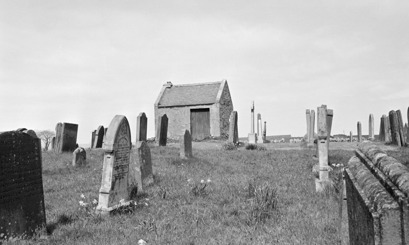 General view of Whitsome Old Parish Churchyard and watchhouse.