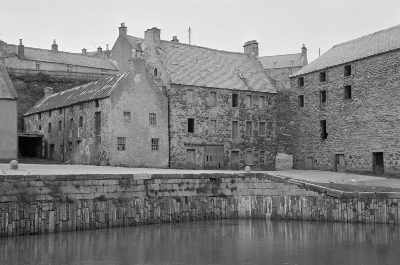 View of warehouse at 10 Shorehead and harbour wall, Portsoy.