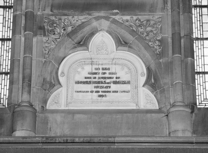 Interior. Detail of commemorative plaque on S wall.