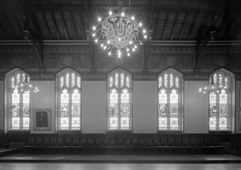 Interior view of Trinity Hall, Union Street, Aberdeen, showing stained glass windows along side wall of large hall.