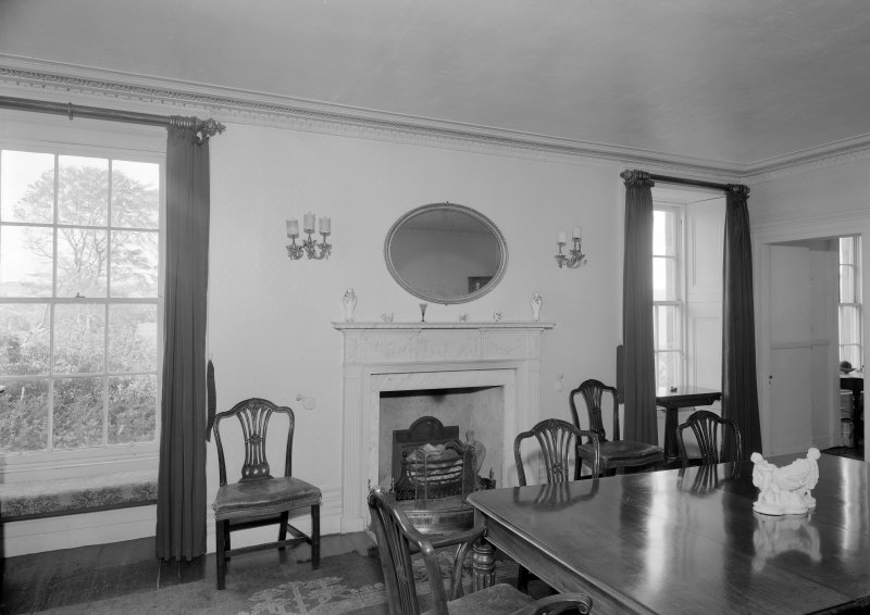 Interior view of Corsindae House showing dining room with fireplace.