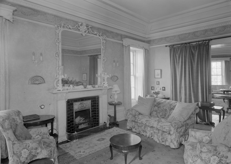Interior view of Corsindae House showing drawing room with fireplace.
